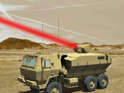 Présentation d'un canon à laser de 60kW embarqué sur véhicule militaire blindé destiné aux forces armées américaines. Illustration: Lockheed Martin